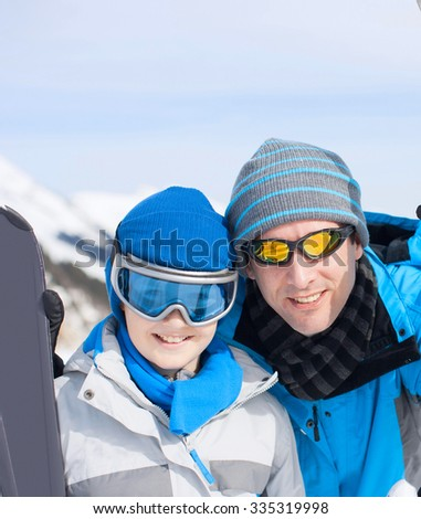 father with child in winter at the mountains
