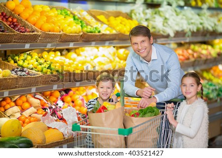 Father with children in a store
