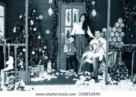 Father with children on christmas holiday - stock photo