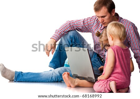 Father with children playing on laptop isolated on white
