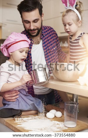 Father with daughters during the baking  - stock photo