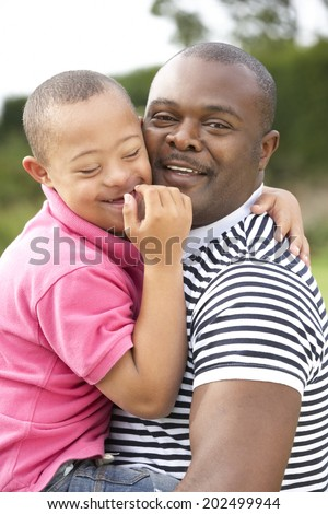 Father with Downs Syndrome son - stock photo