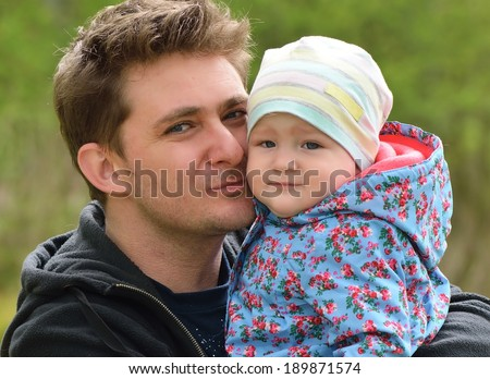 Father with his baby in park. - stock photo