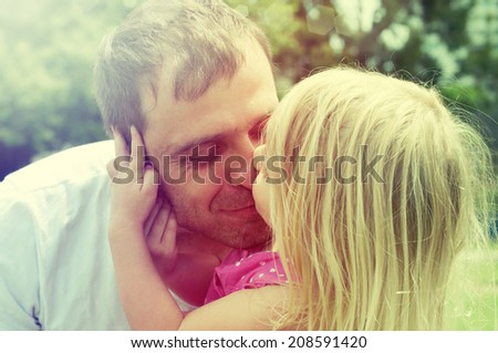 father with his cute little daughter  - stock photo