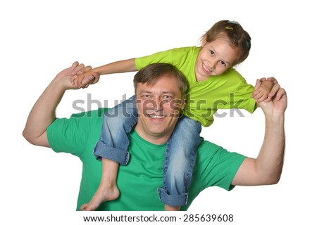 Father with his cute little daughter on white background