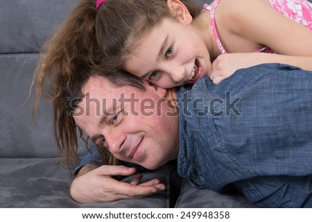 Father with his daughter Relaxing - stock photo