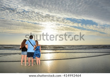 Father with his family enjoying time together, relaxing on vacation. Jacksonville, USA, Florida. - stock photo
