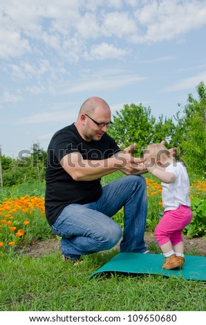 Father with his one year old daughter - stock photo