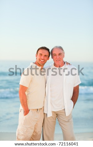 Father with his son at the beach - stock photo