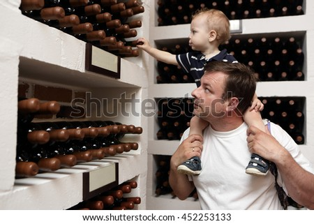 Father with his son have excursion at winery