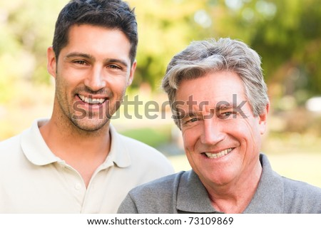 Father with his son looking at the camera - stock photo