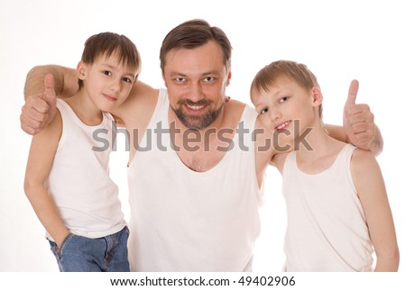 father with his two sons standing on a white