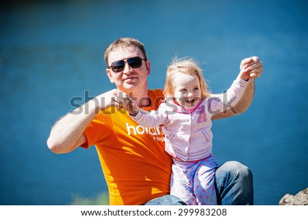 Father with little daughter having fun - stock photo