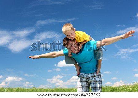 father with little son in summer day outdoors - stock photo