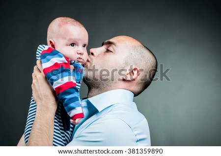 Father with new born baby portrait studio black and white - stock photo