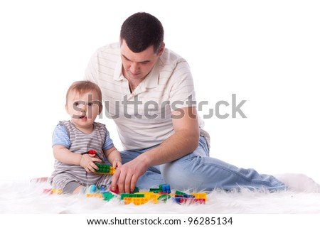 Father with small baby play on a white background. - stock photo