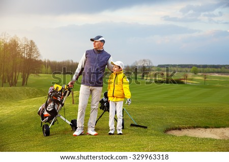 Father with son are training at golf course