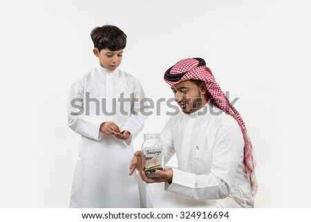 Father with son holding money box