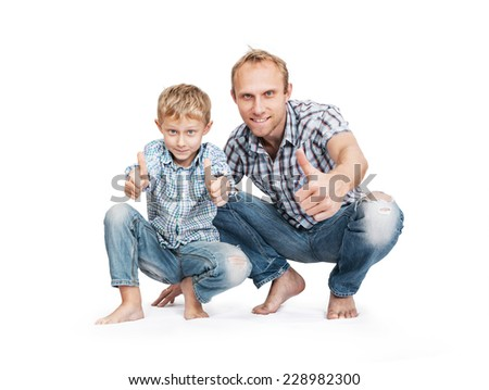 Father with son in blue tattered jeans with great gesture - stock photo