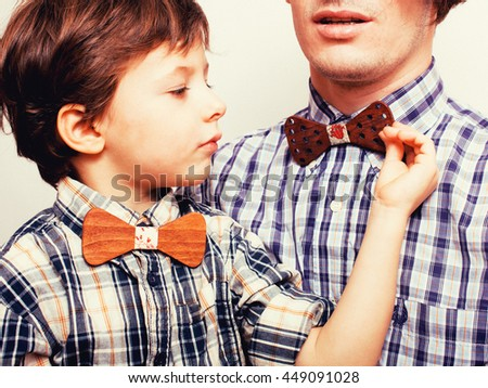 father with son in bowties on white background, casual look - stock photo