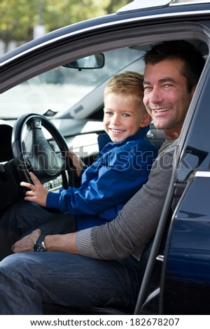 Father with son in car