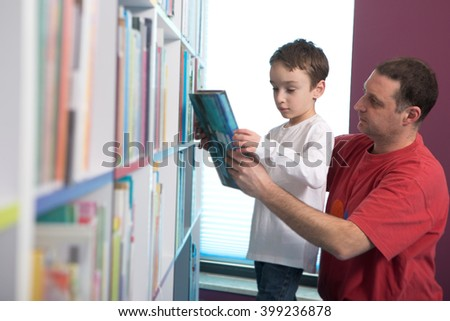 Father with son in library   - stock photo