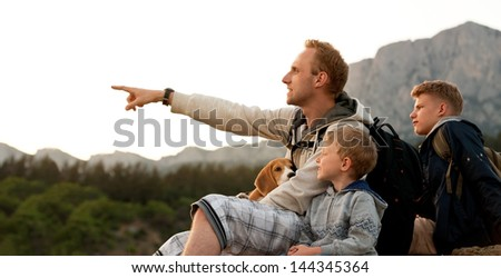 Father with sons have active leisure with climbing