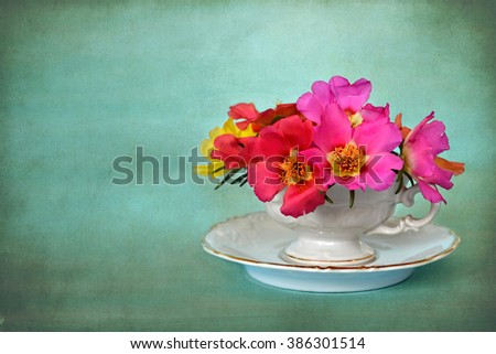 Fathers Day card: Flowers in porcelain cup  on blue background