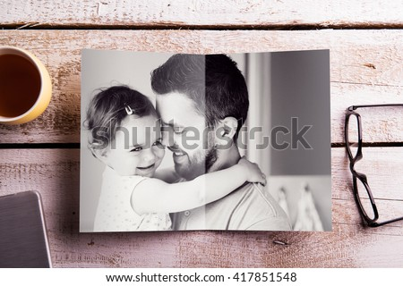 Fathers day composition. Picture of father holding his daughter - stock photo