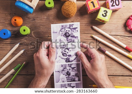 Fathers day composition - toys on floor. Studio shot on wooden background. - stock photo
