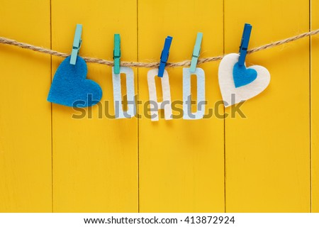 Fathers Day theme with hanging felt DAD letters - stock photo