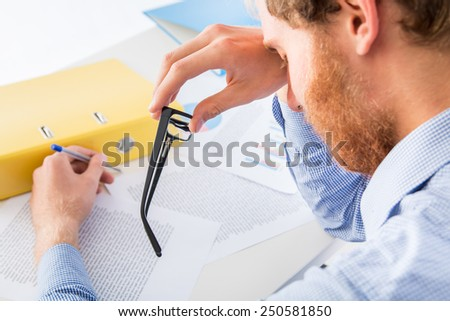 Fatigue while working in the office  - stock photo