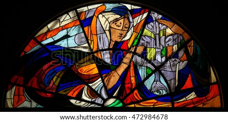 FATIMA, PORTUGAL - JULY 23, 2016: Stained Glass depicting the Apparition of Virgin Mary before the shepherd children at the Sanctuary of Fatima in Portugal.