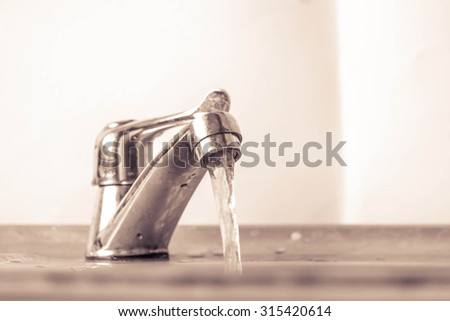 faucet and faucet water and water - stock photo