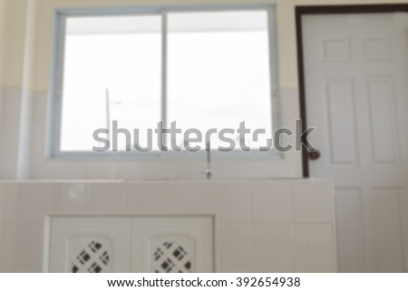 faucet and sink on counter and cabinet in modern kitchen (blurry defocused for interior background)