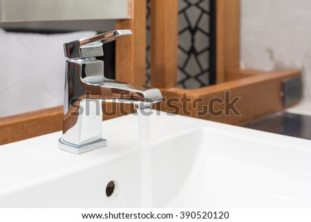faucet and washbasin with water drop at bathroom.