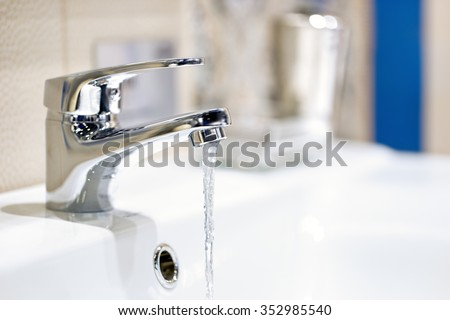 faucet and water flow                   - stock photo