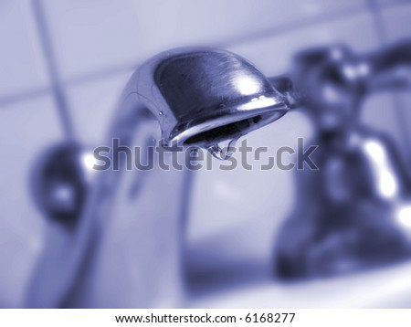 faucet detail with a water drop