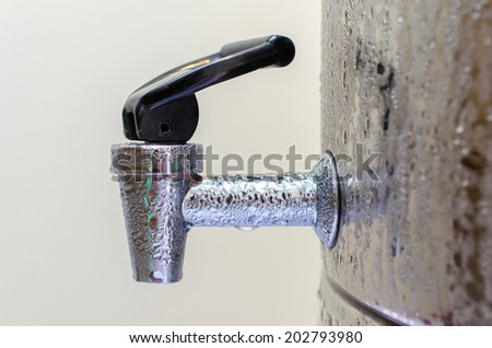 Faucet dispenser and water cooler. - stock photo