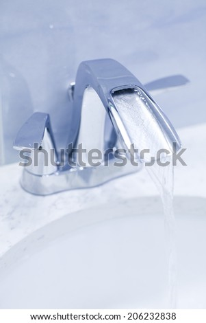 faucet in the bathroom  - stock photo