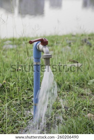 faucet in the park - stock photo