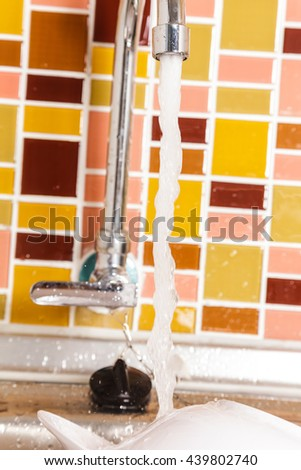 Faucet in the sink with Dirty Plates and dishes - stock photo