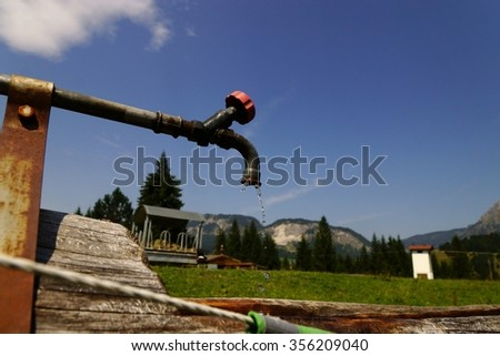 Faucet in the Tyrolean Alps in summer