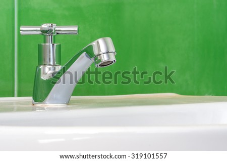 faucet on the sink, ceramic white.