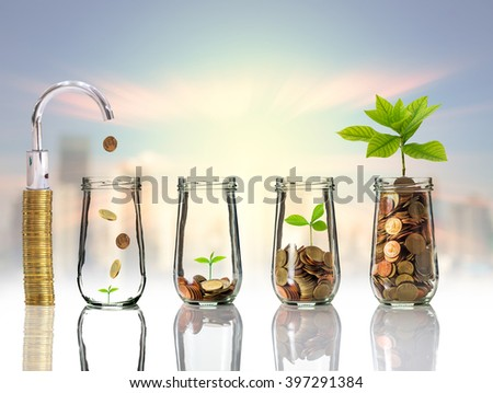 Faucet putting Gold coins and seed in clear bottle on cityscape photo blurred cityscape background,Business investment growth concept - stock photo