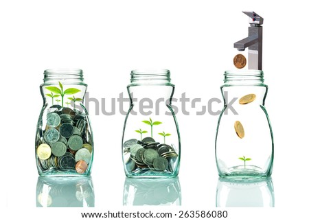 Faucet putting mix coins and seed in clear bottle on white background,Business investment growth concept - stock photo