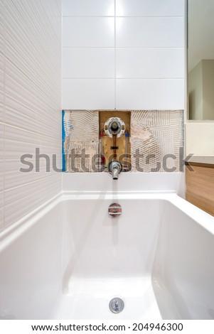 Faucet repair in the bathroom. Broken shower faucet. - stock photo