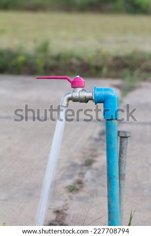 Faucet.The force of the water coming out. - stock photo