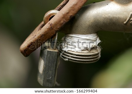 Faucet with a lock - stock photo
