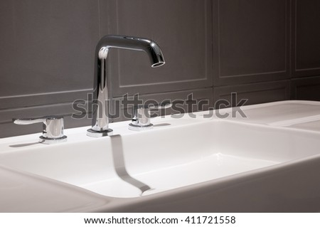 Faucets and sinks, ceramic white, black background.
